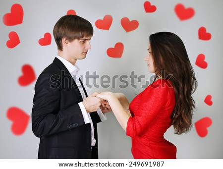 Young beautiful couple in love holding hands - stock photo