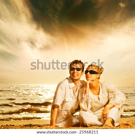 Young beautiful couple in love on the beach - stock photo
