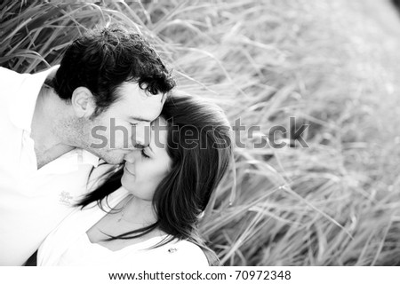 Young beautiful couple in nature - stock photo