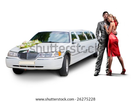 Young beautiful couple with their wedding limousine - stock photo