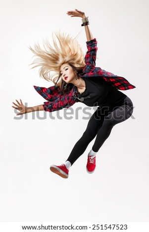 young beautiful dancer jumping on a studio background - stock photo