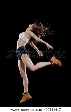 Young beautiful dancer posing in studio - stock photo