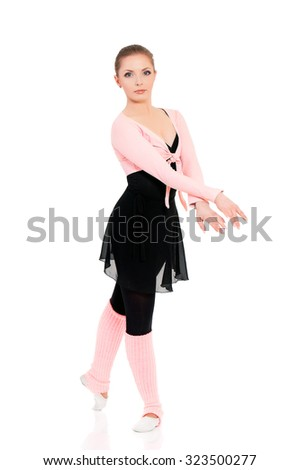 Young beautiful dancer posing, isolated on white background - stock photo