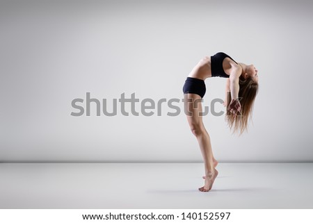 young beautiful dancer teen girl dancing and jumping, studio series - stock photo
