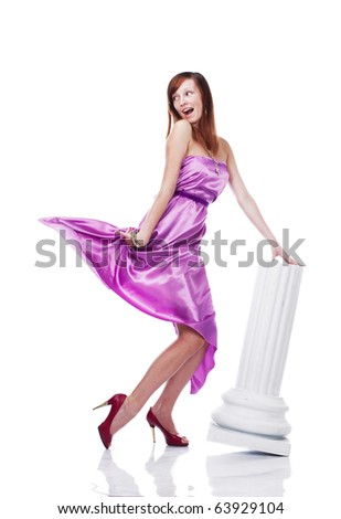 Young beautiful female wearing lilac dress, flirting, isolated on white - stock photo