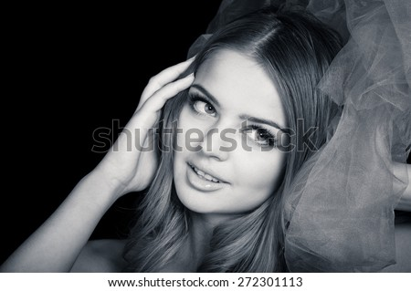 Young beautiful flirting woman, slightly toned black and white portrait  - stock photo