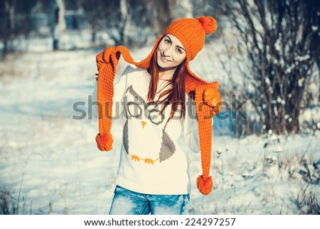 Young beautiful girl are in the winter forest. winter theme - stock photo