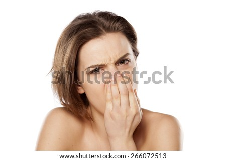 young beautiful girl checks her breath - stock photo