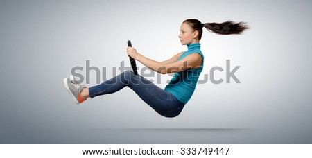 Young beautiful girl driver with a wheel, auto concept - stock photo