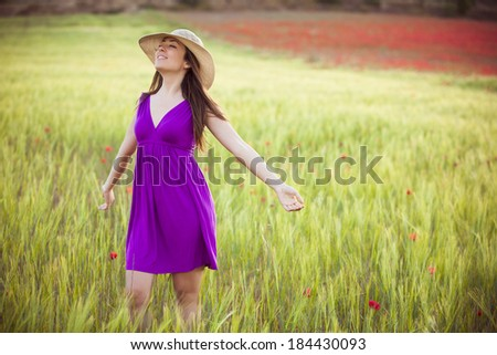 Young beautiful girl feeling freedom on meadow - stock photo
