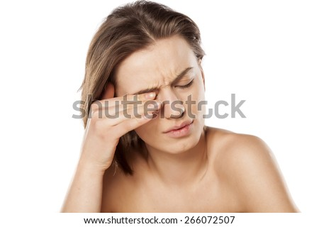 young beautiful girl has a pain in the eyes - stock photo