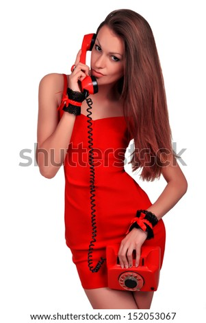 young beautiful girl in a short red dress with a phone. halfbeak - stock photo