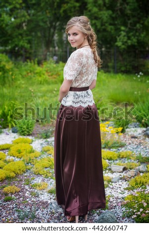 young beautiful girl in an evening dress on nature - stock photo