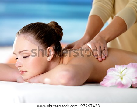 Young beautiful girl in beauty salon getting spa massage - stock photo