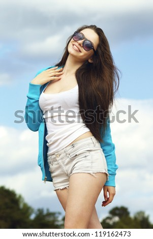 young beautiful girl in casual clothes at the beach - stock photo
