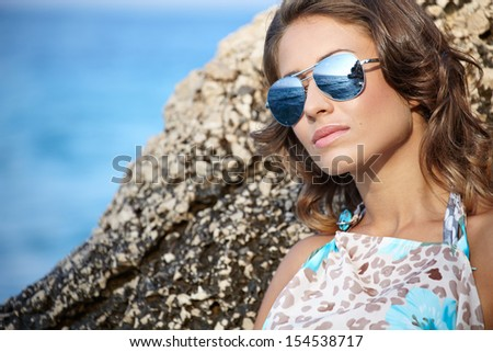 young beautiful girl in dress on the coast  - stock photo