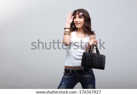 Young beautiful girl in glasses whith bag. - stock photo