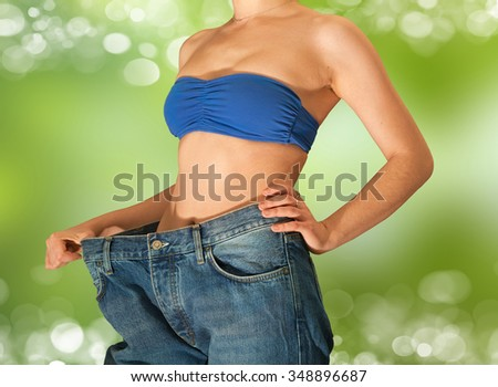 Young beautiful girl in jeans after losing weight - stock photo