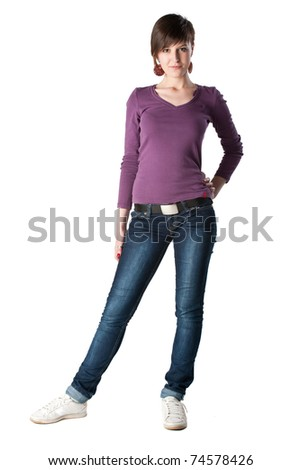 Young beautiful girl in jeans with short hair posing in front of white background. - stock photo