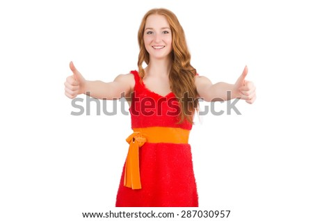 Young beautiful girl in red dress thums up isolated on white - stock photo