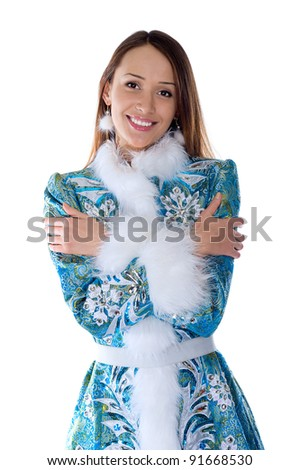 Young beautiful girl in the costume of Snow Maiden looks straight - stock photo