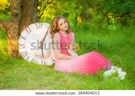 Young beautiful girl in the summer with a rabbit - stock photo