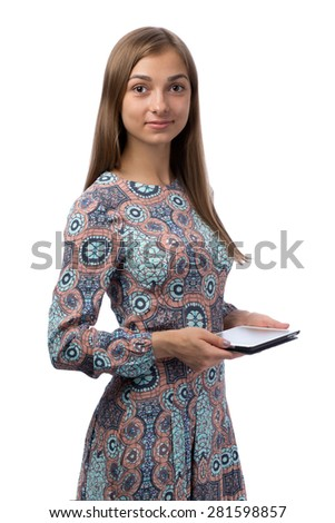 Young beautiful girl in the Tablet PC in the studio, isolate on white background. - stock photo
