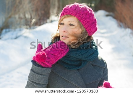 Young beautiful girl in the winter forest - stock photo