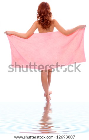 Young beautiful girl in towel after shower with ripples in the water - stock photo