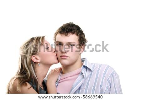 young beautiful girl kissing her boyfriend's cheek - stock photo