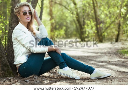 Young beautiful girl listening to music - stock photo