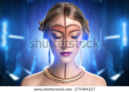 young beautiful girl, model, woman, princess, character, alien. Fabulous, mystical look. Bright, creative, fantasy makeup, futurism style, gold, brown forehead, lines, pattern, nose, neck, pink lips. - stock photo