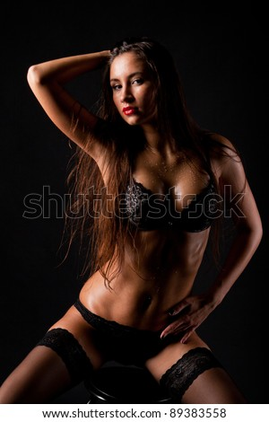 Young beautiful girl naked isolated on a black background - stock photo