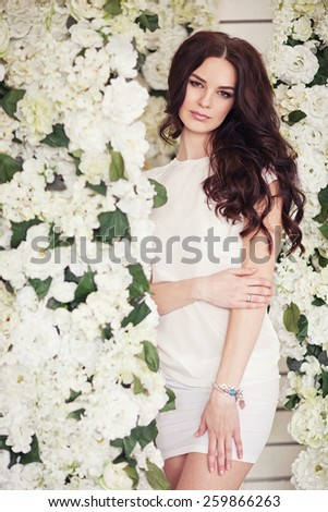 young beautiful girl near white flowers. Spring mood. - stock photo