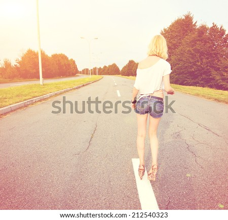young beautiful girl on the free road - stock photo