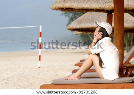 young beautiful girl on vacations at beach - stock photo