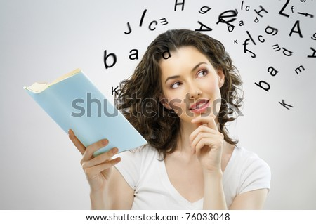 young beautiful girl reading a book - stock photo