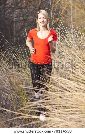 Young beautiful girl running in the autumn environment. - stock photo