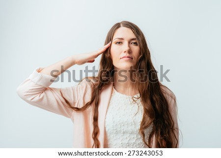 young beautiful girl salutes hand - stock photo