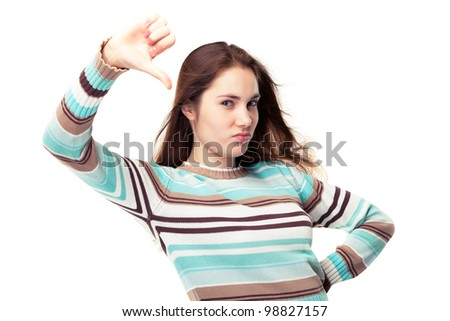 Young beautiful girl showing two thumbs down, waist up isolated on white - stock photo