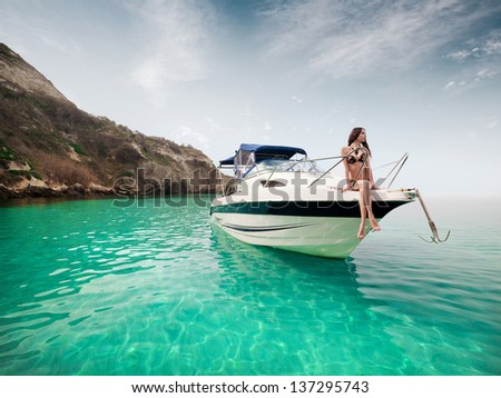 young beautiful girl sitting on a yacht at sea. Relaxing on the water - stock photo