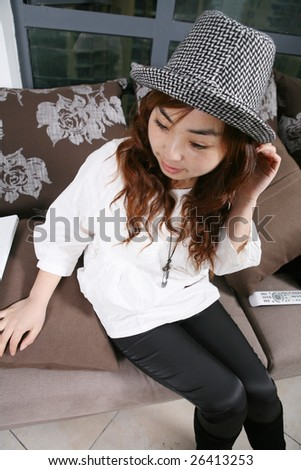 young beautiful girl  sitting on sofa - stock photo