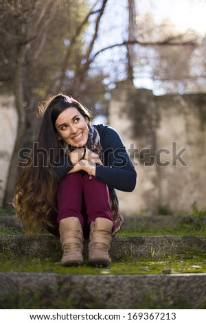 Young beautiful girl smiling cheerfully looking up. - stock photo