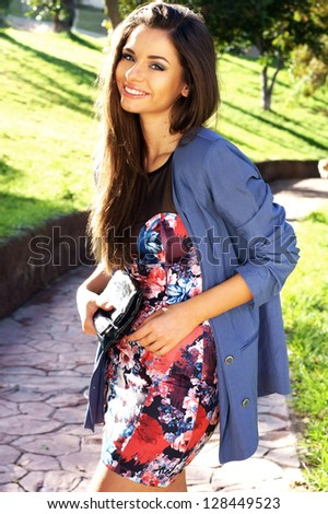 young beautiful girl smiling outdoors - stock photo