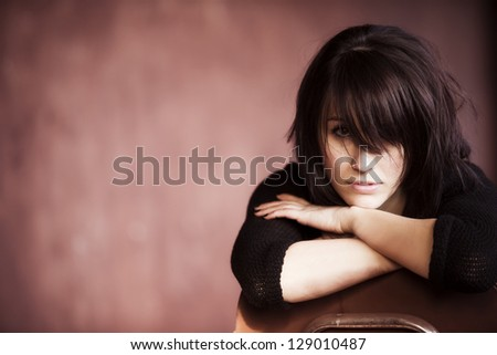 Young beautiful girl staring at camera with messy casual hairstyle. - stock photo