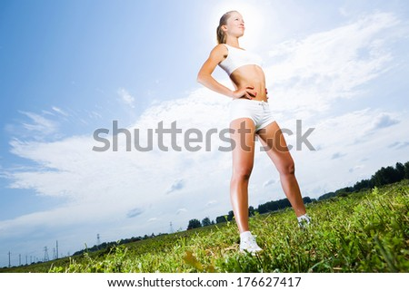 Young beautiful girl training outdoor in summer - stock photo