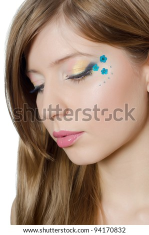 Young beautiful girl with a creative make-up - stock photo