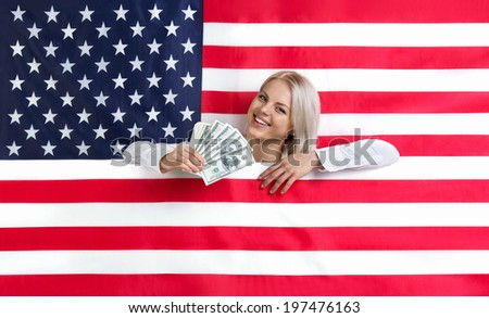 Young beautiful girl with American flag and money - stock photo