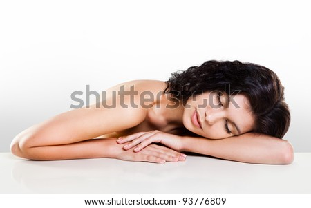 Young beautiful girl with eyes closed - stock photo