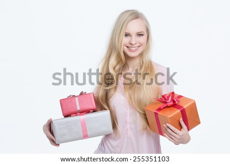 Young beautiful girl with gift isolated on white background. - stock photo